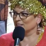 Photo of Tara Russo speaking on Elastic FM's Christmas Eve program about having a mindful Christmas with the family